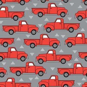 vintage red trucks on grey