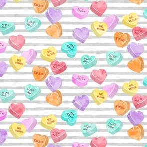 valentines day heart candy - conversation hearts on grey stripes
