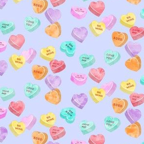 valentines day heart candy - conversation hearts on purple