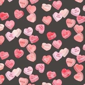 valentines day heart candy - conversation hearts on dark grey (red)