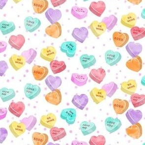 valentines day heart candy - conversation hearts  on  pink spots