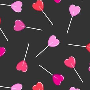 heart shaped suckers - lollipops multi on soft black
