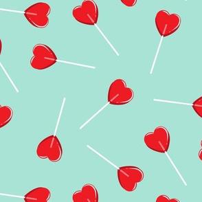 heart shaped suckers - lollipops red
