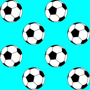 Two Inch Black and White Soccer Balls on Aqua Blue