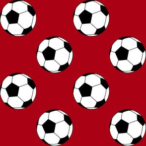 Two Inch Black and White Soccer Balls on Dark Red