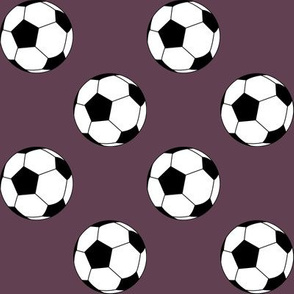 Two Inch Black and White Soccer Balls on Eggplant Purple