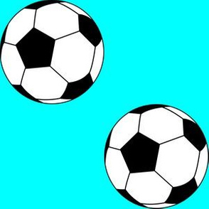 Three Inch Black and White Soccer Balls on Aqua Blue