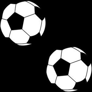 Three Inch Black and White Soccer Balls on Black