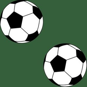 Three Inch Black and White Soccer Balls on Hunter Green