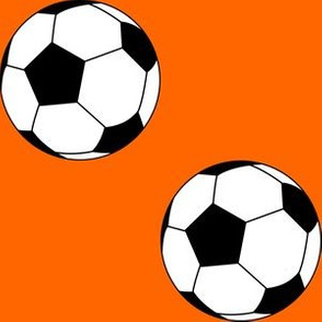 Three Inch Black and White Soccer Balls on Orange