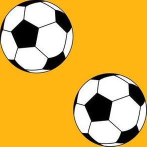 Three Inch Black and White Soccer Balls on Yellow Gold