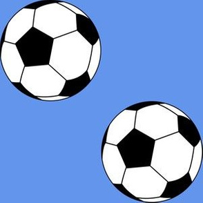 Three Inch Black and White Soccer Balls on Cornflower Blue