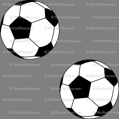 Three Inch Black and White Soccer Balls on Medium Gray