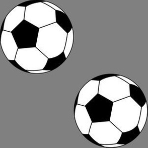 Three Inch Black and White Soccer Balls on Medium Gray