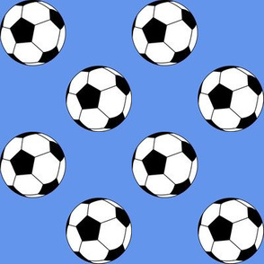 Two Inch Black and White Soccer Balls on Cornflower Blue