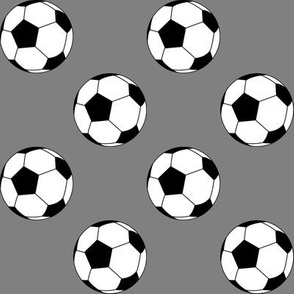 Two Inch Black and White Soccer Balls on Medium Gray