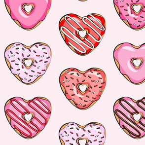 heart shaped donuts - valentines red and pink on light pink