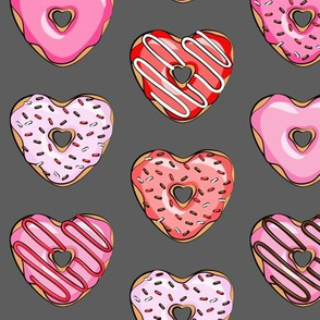 heart shaped donuts - valentines red and pink on grey
