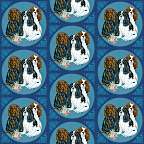 Cavalier King Charles Spaniel dogss on blue tile