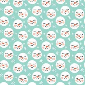 tiny snowman-faces-on-teal
