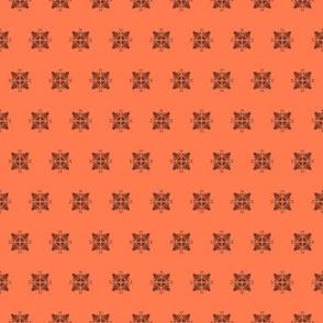 Black lace squares on orange red