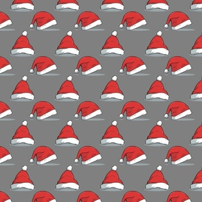 Christmas santa hats on gray