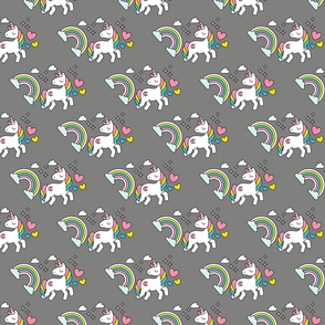 Retro unicorns and rainbows on gray