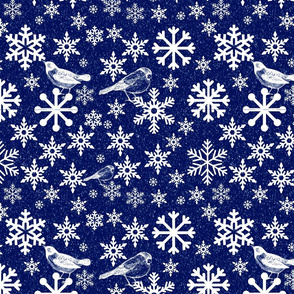 bluebirds in winter with snowflakes