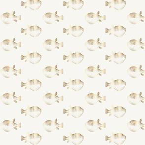 gold blowfish puffer fish on cream ivory