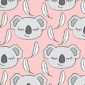 grey koalas on pink