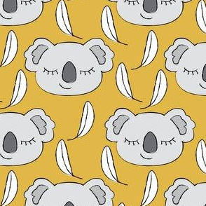 grey koalas on gold