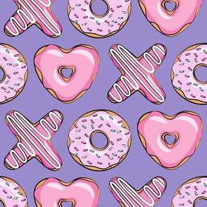 X O  heart shaped donuts -  pink  on purple