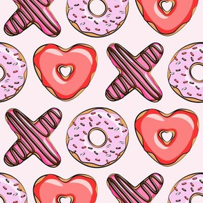 XO heart shaped donuts - valentines red and pink on pink