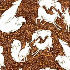 Frolicking foxes in spiced orange