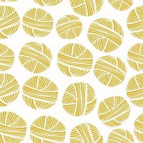yarn balls gold mustard