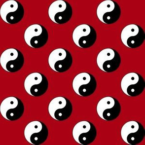 One Inch Black and White Yin Yang Symbols on Dark Red