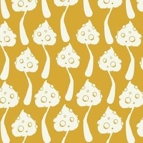 Mushrooms on mustard yellow