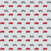 trucks in a row on gray - red and dark gray