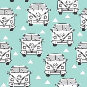 white camper vans on teal