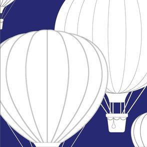 White hot air balloons on dark blue