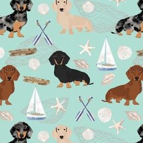 Doxie Coastal fabric - dogs at the coast, summer, sand dollar, beach design - mint