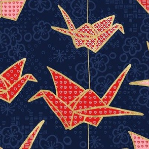 Red origami cranes on navy blue