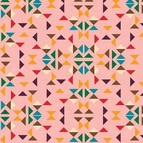 kilim triangle pink background