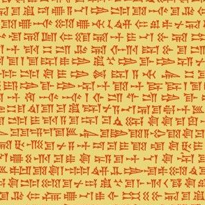cuneiform writing - orange on gold