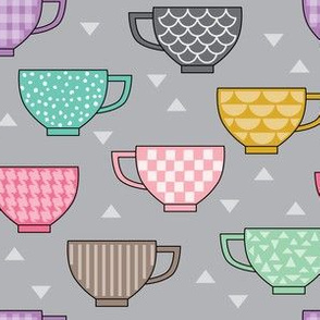 teacups with patterns on grey