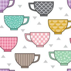 teacups with patterns on white