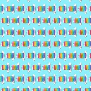 """(3.4"""") rainbow cake on blue (90)"""
