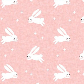 bunnies on pink linen