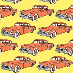 Nifty Fifties 1955 Studebaker orange on yellow