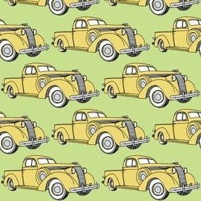 yellow 1937 Studebaker pick up truck